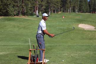 Hall of Fame running back and ex-Raider Marcus Allen practices on the driving range prior to the start of the eighth annual Gene Upshaw Memorial Golf Classic Monday at Schaffer's Mill Golf Club in Truckee.