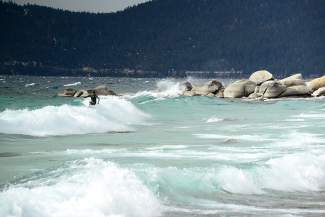 Mickey Gardner and Kevin Hair of Incline Village caught some waves on Lake Tahoe Thursday afternoon off Hidden Beach. Thursday's storm eventually brought snow up top — during the day, it brought heavy winds throughout the region.