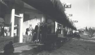 Eldon Tonini and another woman stand next to Gateway Bottle Shop, a generation before the store would become Zander's Spirits, Etc.