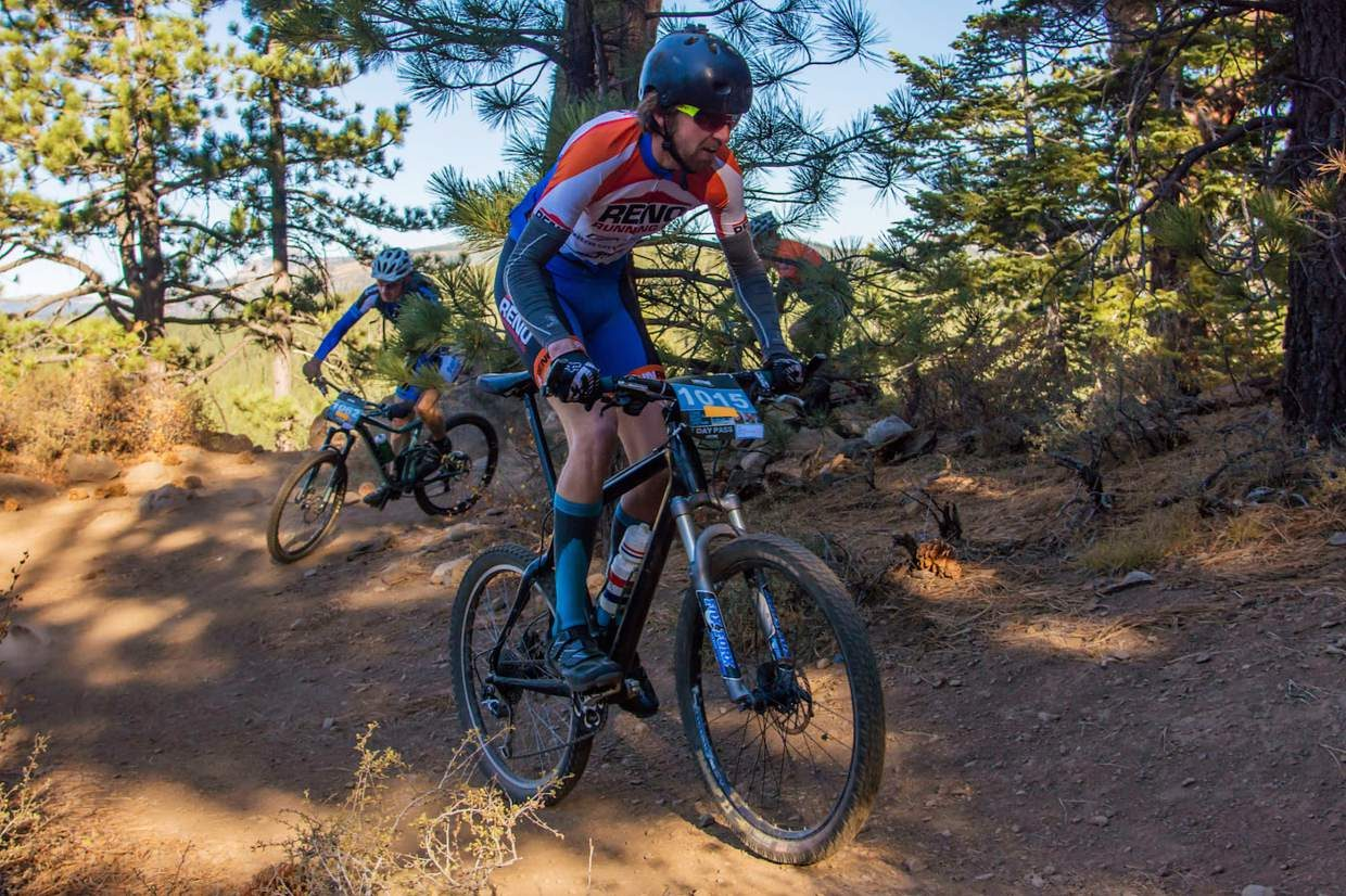 JP Donovan of Incline Village, center, and Garry Morgan of Truckee, left, ride along on the Elite Bike Course.