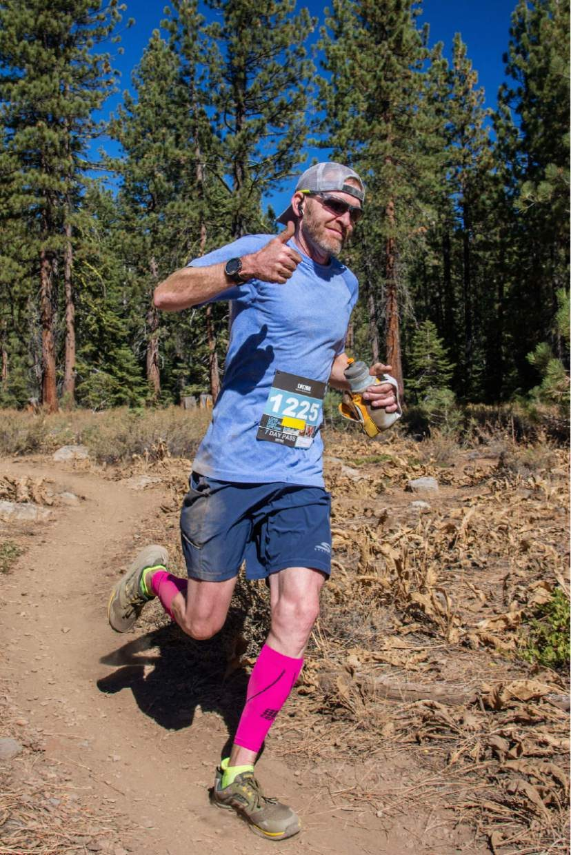 Reno's Jeff Huxhold roams the trails of the Elite Run Course during the Great Trail Race on Sunday. Huxhold won the elite running title.