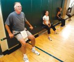Participants in a Winter Sports Conditioning class at the Incline Village Recreation Center work on lower body strength.