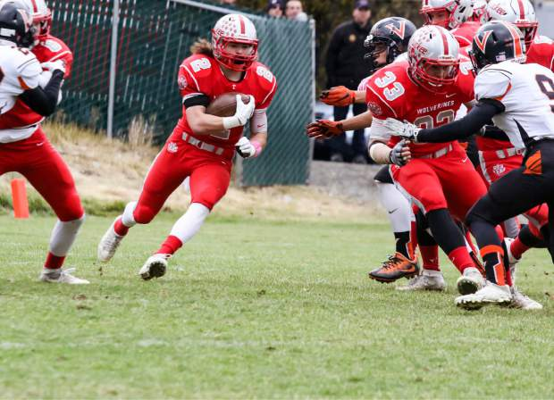 Truckee running back Cole Harrity cuts through a hole as fullback Wulfe Retzlaff, right, prepares to lay a big block on Fernley's Chayce Diebler.