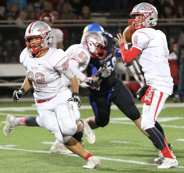 Truckee quarterback Jayden Commendatore, right, looks to make a pass as Chuy Diaz, left, runs upfield to block.