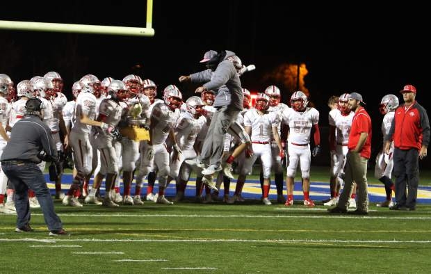 Truckee head coach Josh Ivens leaps in celebration following the Wolverines' 21-20 win over South Tahoe in the latest installment of the Sierra Bowl.
