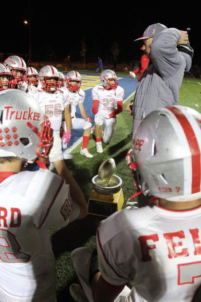 Truckee head coach Josh Ivens gives a post-game speech to his team after Friday's Sierra Bowl win.