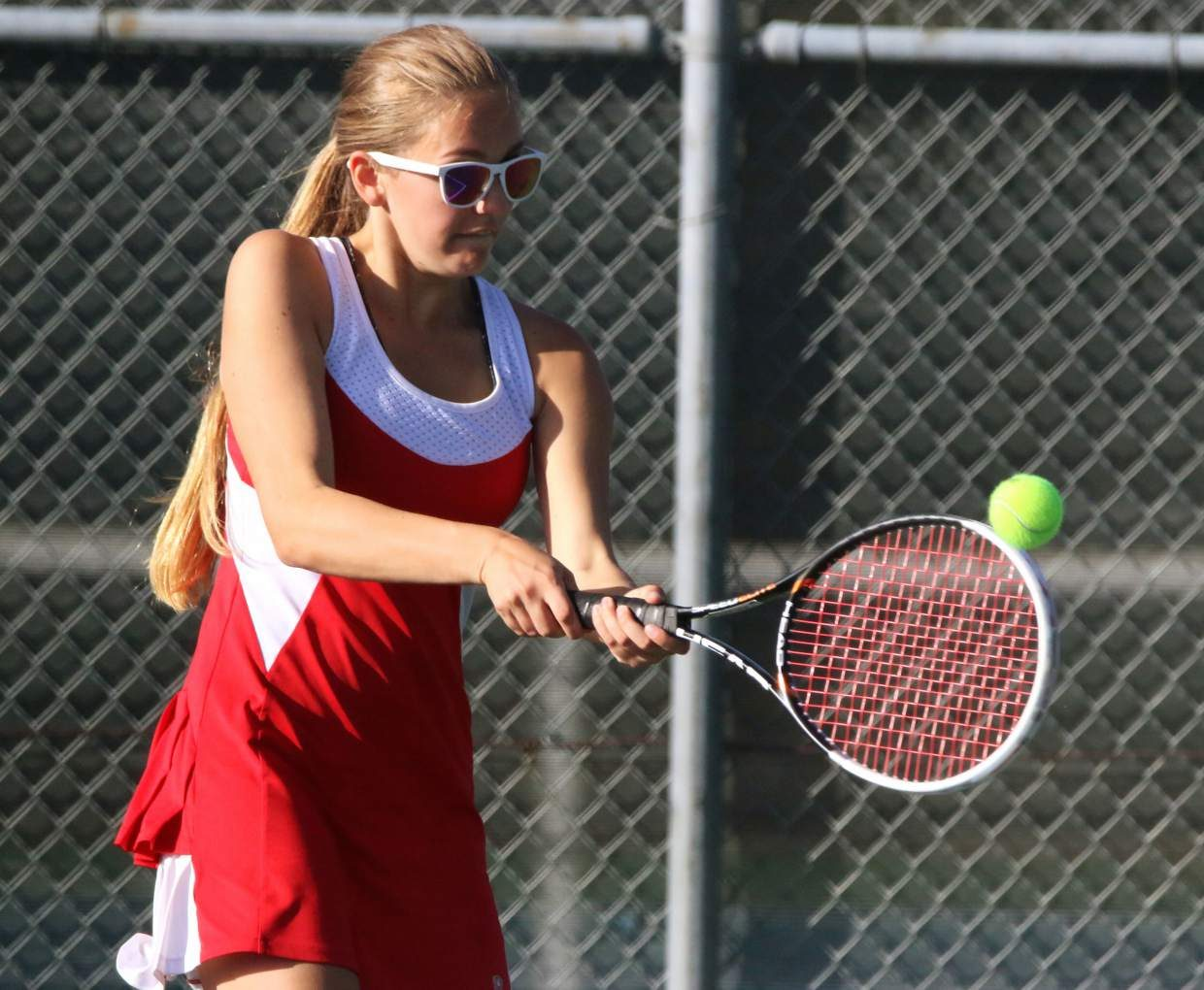 Truckee's Rebecca Ziegler attempts to make a backhanded return against Fallon on Friday.