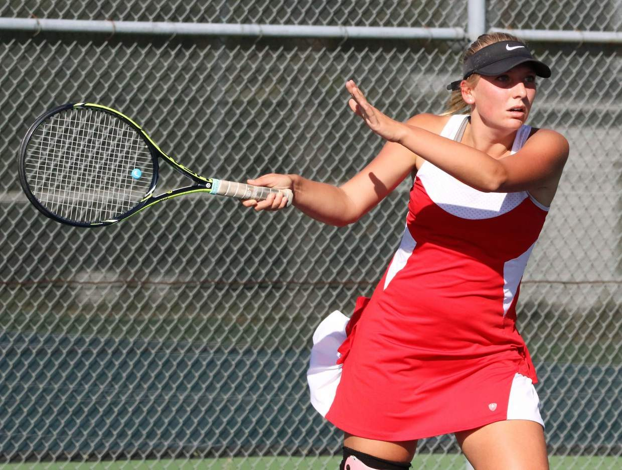 Trukee's Maya Willis follows through after making a backhanded shot during singles play against Fallon on Friday.