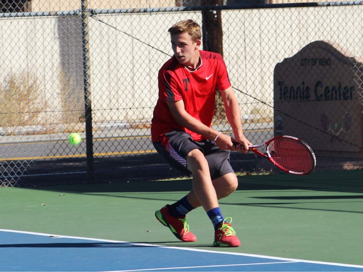 Truckee's Zach Haas eyes up a backhand return during the Wolverines' 10-8 loss to South Tahoe in the 3A Northern Region finals on Friday at the Reno Tennis Center.