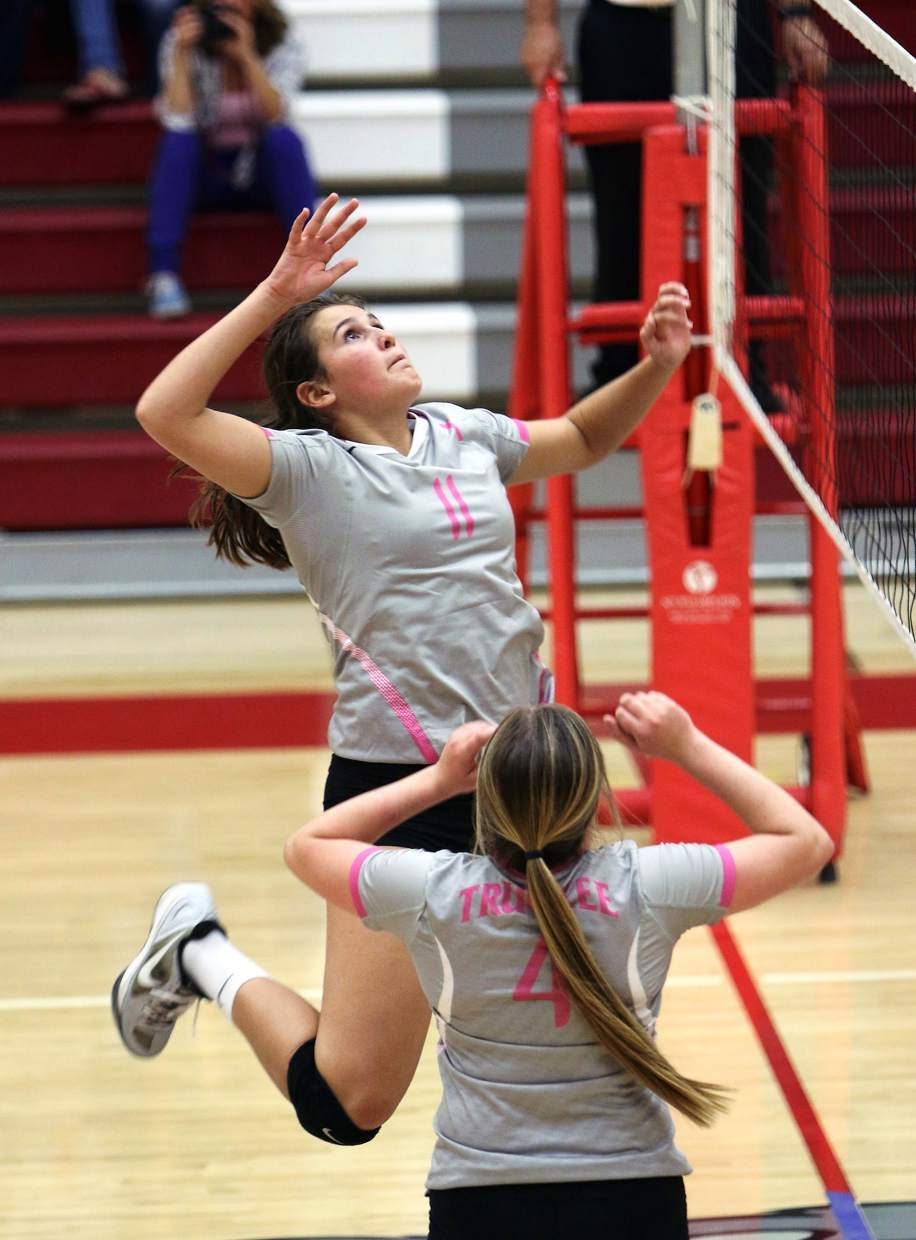 Truckee's Kelly Cross rises for a spike during the Wolverines' home win over Fallon on Monday.