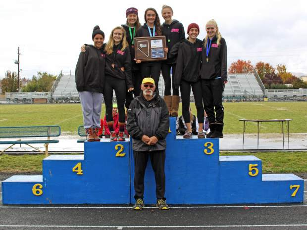 The North Tahoe girls cross country team stands on the podium after claiming first place at the NIAA Northern Region Championships on Friday in Sparks.