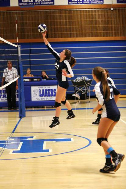 North Tahoe sophomore Sarah Shoberg tips the ball over the net to score a point for the Lakers.