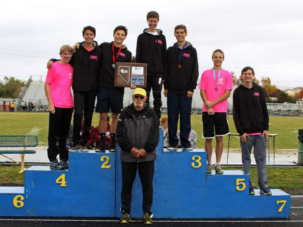 The North Tahoe boys cross country team stands on the podium after claiming first place at the NIAA Northern Region Championships on Friday in Sparks.