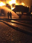 Fire crews battle the blaze during the early morning hours Wednesday.