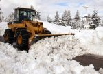 Snow-removal crews were hard at work last week, especially on Friday when the storm broke. Here, a plow works in the area of Village Green Mobile Home Park in Truckee.