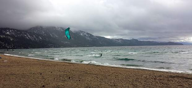 Surf's Up: A hearty kite surfer braves a blustery, raw wind at Incline Beach in mid-December.