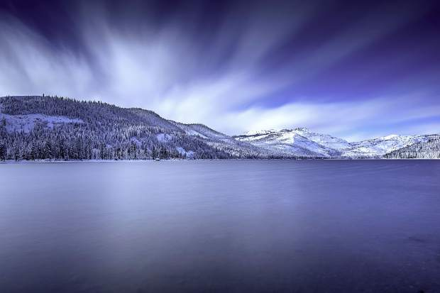 Glass And Flash: Donner Lake shimmers the morning of Jan. 7 after a big snow storm. Photo: Chris Turner / Rimfire Photography
