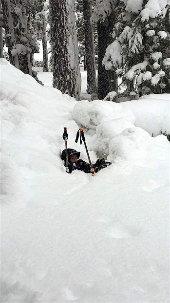 Peek-A-Boo: Young Branden fell in a hole while snowshoeing in Tahoe Vista on Jan. 10 due to the deep snow. Photo: Margie Lockwood
