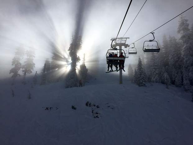 Snowy And Surreal: Taking a quiet ride up the Crow's Nest lift at Sugar Bowl Resort on Jan. 14. Photo: Ken Kirschenman