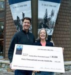 Blake Riva, left, of Mountainside Partners hands a check for $40,000 to Lisa Wallace of the Truckee River Watershed Council.