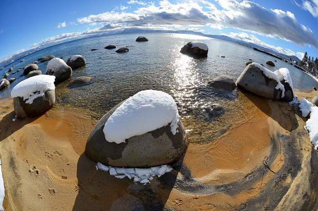 Sunny Surprise: Lake Tahoe is seen from Speedboat Beach on the California-Nevada border on Jan. 26, one of the few recent days featuring sunshine in the region. A Nikon 8.5mm fisheye lens was used get this effect. Photo: William T. Doyle