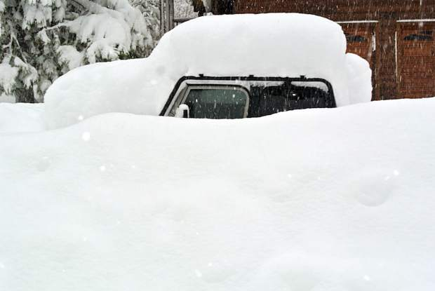 Janu-Buried: A Jeep in Carnelian Bay is only barely covered in snow at the end of January. Photo: Matt Dodge