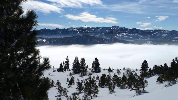 Rolling On In: Fog socks in above Donner Lake looking south to the Pacific Crest Trail in late January. Photo: Carol Herrington