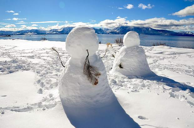 Tahoe Snow People: These snow people were standing at the south end of the parking lot at Cave Rock State Park on Feb. 20, looking toward the West Shore. Photo: William T. Doyle