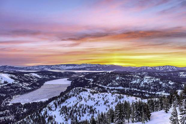 Fire And Ice: The sun rises over Donner Lake the morning of March 6, after a recent snowstorm. Photo: Chris Turner / Rimfire Photography