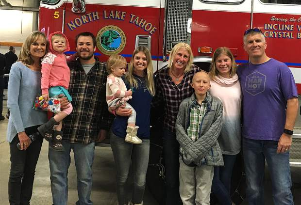 DONATIONS THAT MAKE A DIFFERENCE: From left, local residents/family members Allison Hartman, Kenzie, Scott Yorkey, Kyla, Shelby Yorkey, Jill Whisler, Tyler, Sydney and Alan Whisler were among those on hand March 10 for a free barbecue hosted by North Lake Tahoe Fire Protection District Local 2139 and Truckee Meadows Fire Protection District Local 3895. The event took place at NLTFPD Station No. 11. Local families affected by cancer were given station tours and fire engine rides and then presented with proceeds from funds raised during the past year for the Northern Nevada Children's Cancer Foundation. Proceeds will help the families with medical and travel expenses not covered by insurance. Visit nvchildrenscancer.org to learn more.