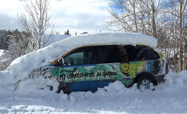 My Other Car Is A Canoe: This snowed-in vehicle, seen after snowmelt in mid-March, was painted by Emily and Rachel Jones of Glenshire. Photo: Stacy Jeremias