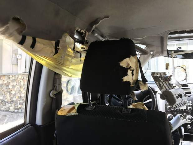 A bear became trapped in this vehicle. It was later determined to be totaled.