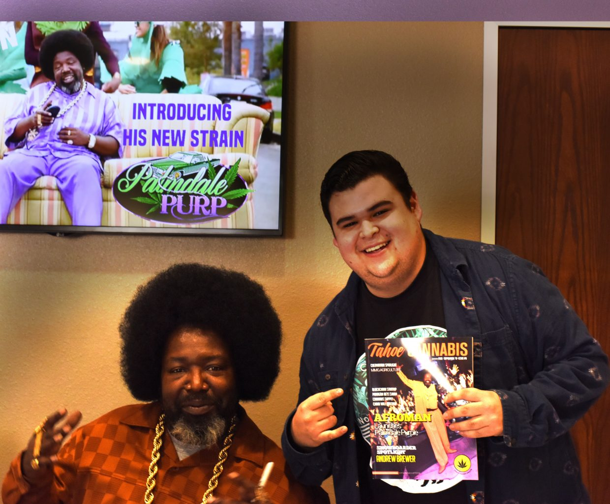 Afroman poses with a fan during a meet and greet at NuLeaf Tahoe on Sept. 25.