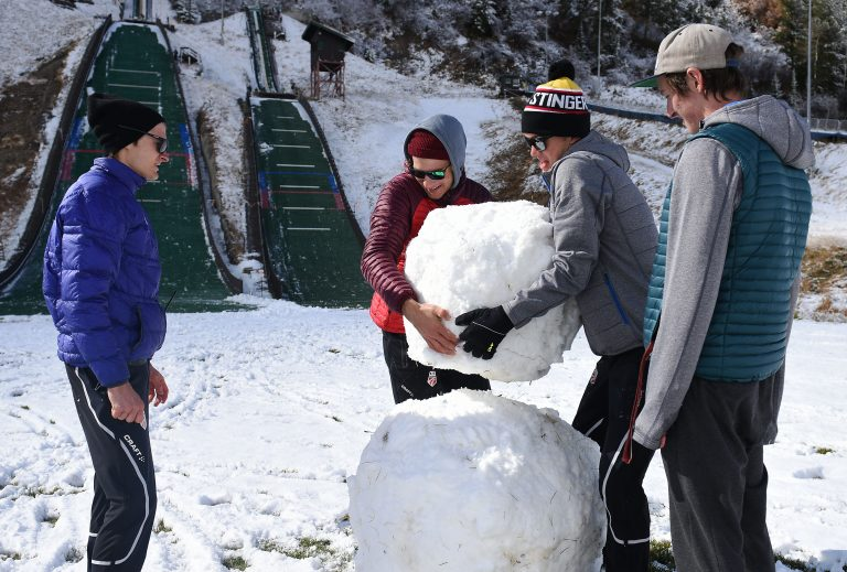 U.S. Nordic combined skiers Ben Loomis, left, and Jasper Good lift the body of their snowman into place at the base of Howelsen Hill on Saturday.