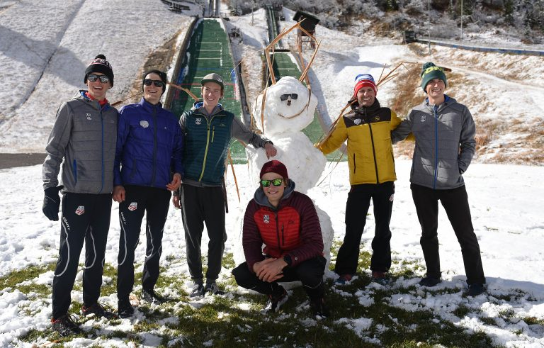 Members of the U.S. Nordic Combined Ski Team pose with their creation on Saturday at Howelsen Hill. The builders were, from left, Jasper Good, Adam Loomis, Stephen Schumann, Ben Loomis, Bryan Fletcher and Grant Andrews. They tore down the snowman shortly after finishing it.