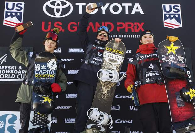 Chandler Hunt, Mons Roisland, and Chris Corning at the podium following the big air final the U.S. Grand Prix event Sunday, Dec. 10, at Copper Mountain.