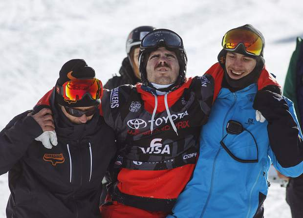 France's Benoit Valentin is helped off halfpipe following a crash during the finals at U.S. Grand Prix event Friday, Dec. 8, at Copper Mountain.