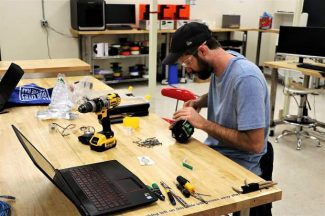 Mike Gillette, co-founder of Nevada Connection Solutions, working in the MakerSpace at the Innevation Center.