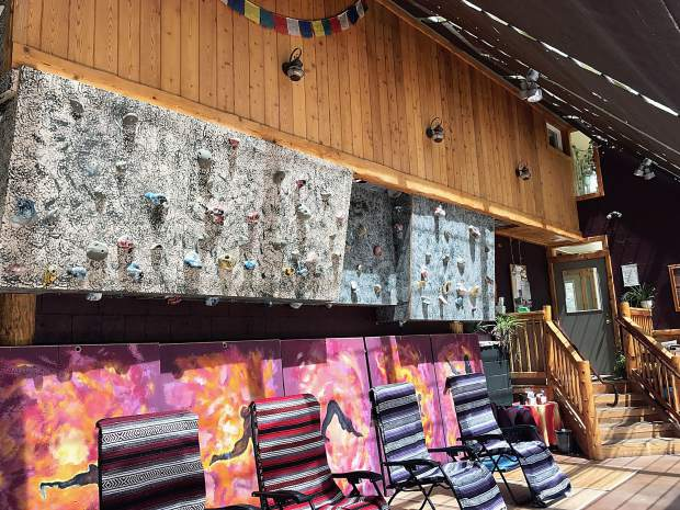 When not used for community acupuncture, the sunny space is home to a rock climbing wall and is used for yoga and tai chi sessions.