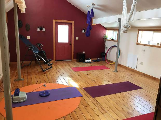 The upper floor of the center houses a Pilates reformer, inversion table, aerial yoga hammocks and equipment for bodywork.