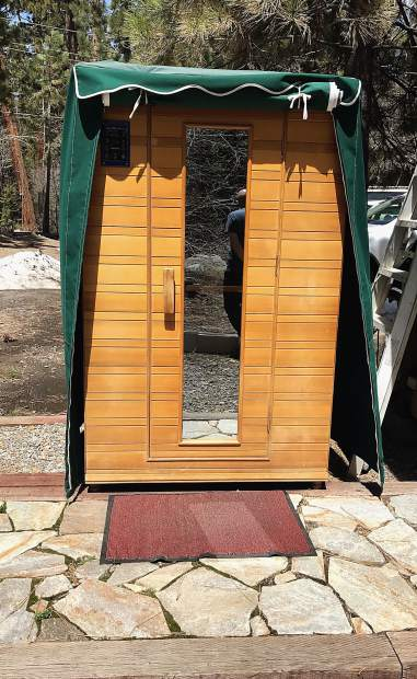 The infrared sauna is located outside, near a private creek area with shower amenities.