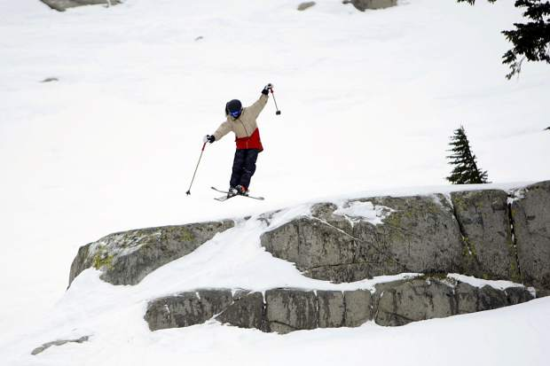 A youngster flies off a cliff at Squaw Valley's North Bowl on Sunday, Feb. 11.
