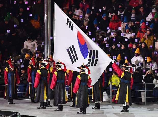 The South Korean flag is presented at the 2018 Winter Olympics Opening Ceremonies.