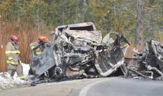 Firefighters inspect the wreckage of one of the vehicles involved in Wednesday morning's fatal head on collision along Highway 20 in rural Placer County.