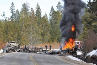 First responders assess the scene of a two commercial fatal vehicle head-on collision that left a burning wreck alongside Highway 20 near the Interstate 80 interchange.