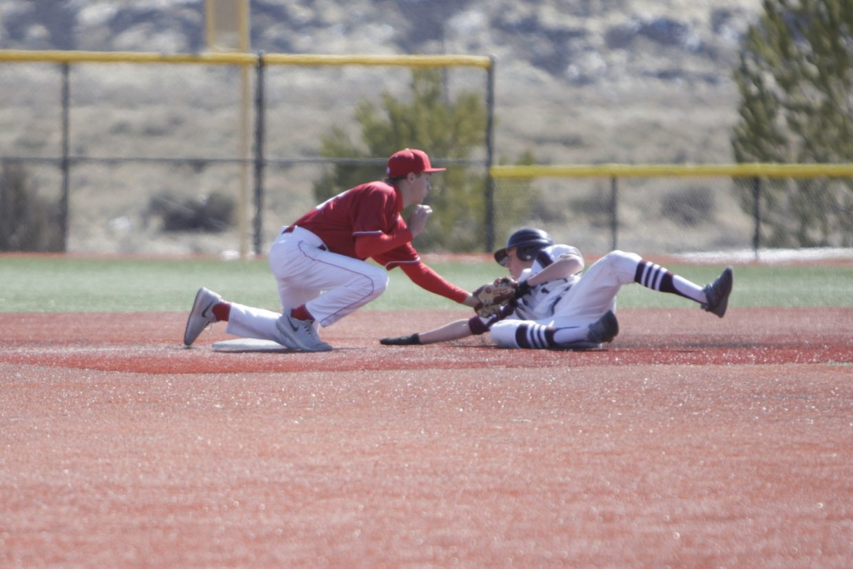 Truckee's Gary Grosjean applies a tag to a Dayton runner on Monday, March 19. Officials ruled the runner safe at second base.