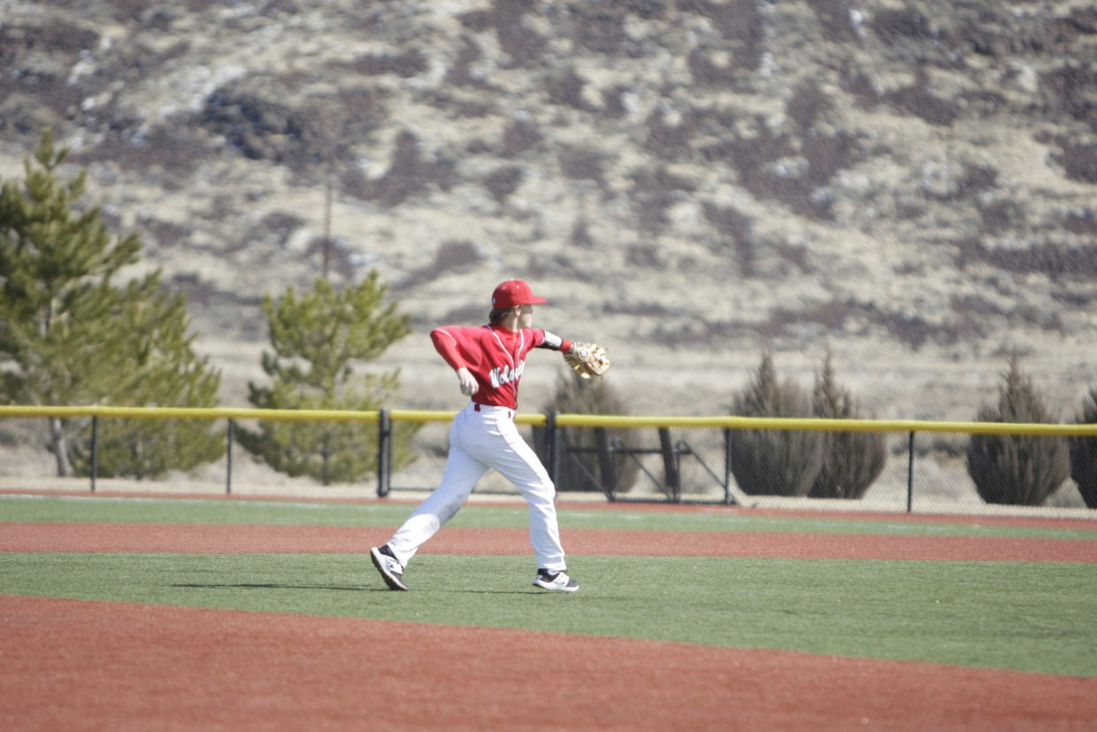 Tyler Estabrook fires a ball to first base during Truckee's 7-3 win over Sparks on Monday, March 19.