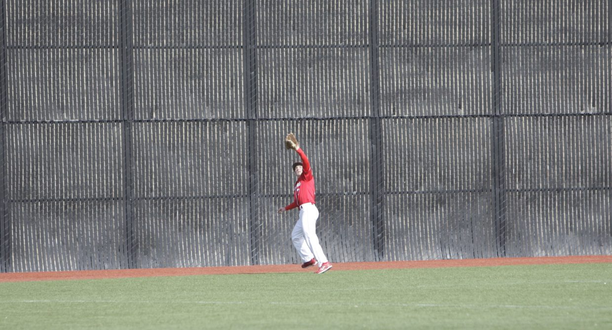 Joel Estabrook hauls in a flyball during Truckee's 7-3 victory over Sparks on Monday, March 19.