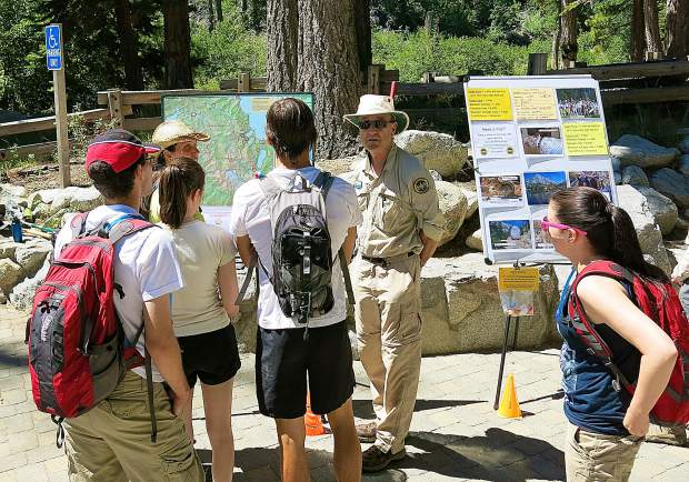 A volunteer educates visitors at a trailhead in Desolation Wilderness.