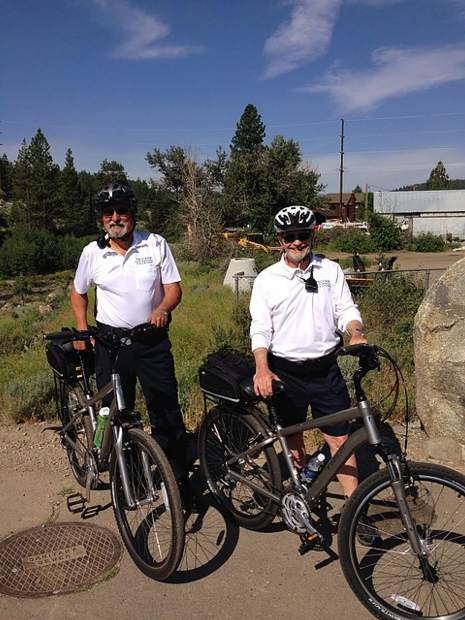 Al Salas, left and Gary Thomas provide pedal power for the Volunteer In Police Services program with the Truckee Police Department. Volunteers have donated more than 34,000 hours, saving nearly $1.2 million for the Town of Truckee since the program's inception.